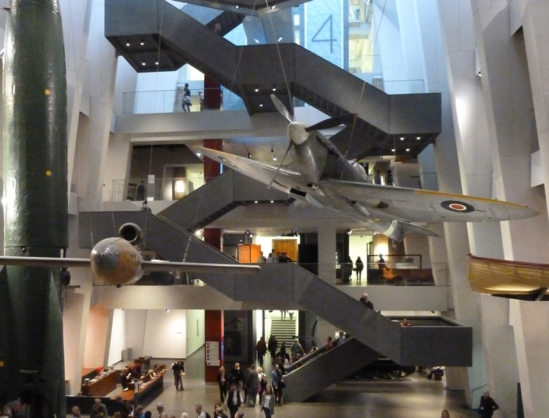 The view through the atrium towards the cantilever stairs and the Spitfire .